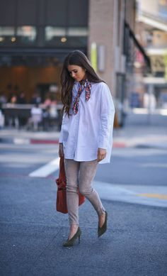 With a bandana scarf, suede pants, and a pair of pumps.