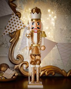 """Nutcracker made of wood, polyester, and plastic. 6""""W x 4.5""""D x 24""""T. Imported."""