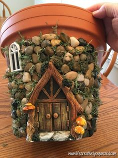 Here's how to make a sweetly whimsical DIY fairy house planter from a terra cotta pot & other inexpensive items. It's really easy, so why not give it a try? #garden_crafts_terra_cotta