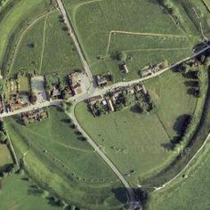 Avebury, Wiltshire, UK - a village in a stone circle   Contained within a giant circular henge about 430 metres across, the site of Avebury rivals, and some would say surpasses Stonehenge for its sheer scale and impressiveness.