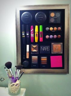 Much better than digging in my make up bag everyday!  Magnetic Make-up board. Cover a sheet of metal with fabric and glue to a frame. Add small magnets to the back of your make-up products.