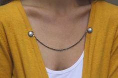 Hey, I found this really awesome Etsy listing at http://www.etsy.com/listing/119178209/pearl-sweater-guard-cardigan-clip-collar