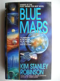 """The novel """"Blue Mars"""" by Kim Stanley Robinson was published for the first time in 1996. It won the Hugo and Locus Awards. It's the third novel in the Mars trilogy and follows """"Green Mars"""". Cover art by Don Dixon for an American edition. Click to read a review of this novel!"""