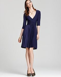 This is sweet.    BCBGMAXAZRIA Three-Quarter Sleeve Pleated-Skirt Dress  PRICE: $298.00