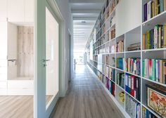 Long and narrow brick house featuring a 17-metre-long bookshelf.
