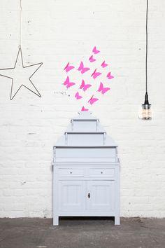 Pink butterflies and a grey dresser