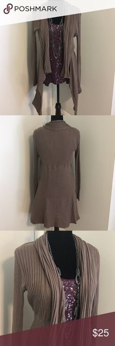 🆕Merona taupe asymmetrical cardigan Merona taupe asymmetrical cardigan looks great with slacks, jeans or skirts! Put it over your favorite blouse or tank, dress it up for the office or evening out or down for weekend wear! Merona Sweaters