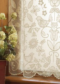 Popular folk art themes from nature with whimsical birds are echoed in the fine-gauge lace Rhapsody Panel.  Shop at www.oldeworldelace.com