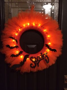 Halloween tulle wreath - it took 3+ rolls of tulle on a styrofoam wreath, which I wrapped in orange ribbon first and pinned the words and bats to it