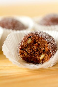 Chocolate Bourbon Balls - a no-bake, truffle type cookie that packs the punch of a good bourbon - one of my favorites!  I roll mine in powdered sugar instead of granulated, but it's the filling that counts - YUMMY....