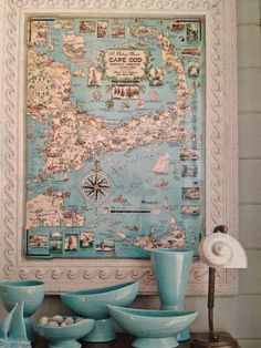 Framed turquoise and white map. Turquoise pottery. Shell. Old radio. Love this beach theme decor!