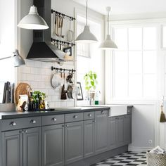 subway tile and grey cabinets