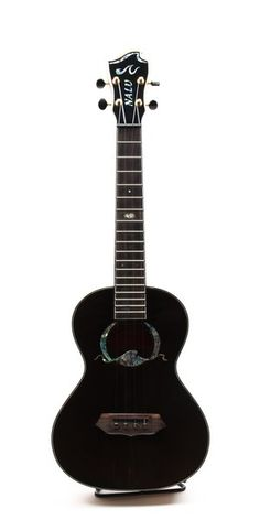 This ukulele is hand made in China to the exact specifications of the Nalu Ukulele Company. The Kaiko'o tenor features a gloss finished, black stained solid Sitka spruce top with solid Zebrawood  back and sides. The nut and saddle are Graph Tech Black Tusq and the soundhole rosette is abalone. The neck is mahogany with Grover open geared gold tuners and a very comfortable 1-5/16 nut width.It is a great, attractive player at a very reasonable price.