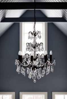 "This classic chandelier with a contemporary touch is from our feature ""Black Magic"""