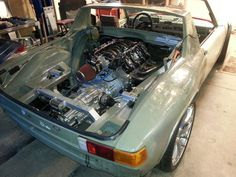 Porsche 914 has stuffed a LS6 V8 and Porsche G50 five-speed transaxle behind the seats. The car's suspension is from a 2004 Porsche 996. The owner took the car out for a quick drive and said it is like riding a bull. I am sure this will be one amazing Porsche 914 when completed.