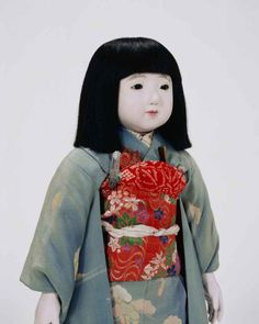 This Friendship Doll is Miss Ibaraki, also known as Kasumi Tsukuba. She represents Ibaraki Prefecture, located in central eastern Honshu, and is named for two of the prefecture's most famous landmarks: Lake Kasumigaura and Mount Tsukuba. Like the other prefectural Friendship Dolls, she was made by the Yoshitoku Doll Company in Tokyo.