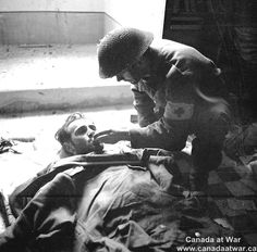 Flynn of the Seaforth Highlanders of Canada giving a drink of water to a badly-wounded German prisoner inside a church, Ortona, Italy, 21 December Canadian Soldiers, Canadian Army, Canadian History, Military Photos, Military History, Remembrance Day, Video Photography, Stunning Photography, Faith In Humanity