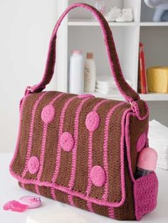 ideas for crochet diaper bagCrochet - Patterns for Children & Babies - Accessory Patterns - Polka-Dot Diaper BagCrochet Purse Patterns - Page diaper bag or nappy bag is a storage bag with many pocket-like spaces that is big enough to carry everyth Crochet Diaper Bag, Crochet Baby, Free Crochet, Diaper Bag Patterns, Crochet Purse Patterns, Crochet Handbags, Crochet Purses, Crochet Accessories, Baby Accessories