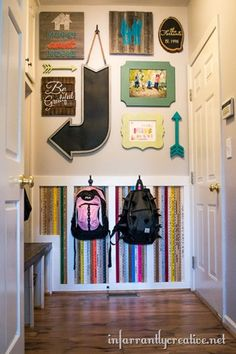 Great Mudroom + wall of yardsticks + family gallery wall