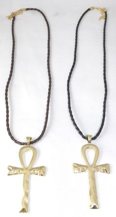 """Metal Ankh Pendant Necklaces  12"""" Faux leather cord; 3.5"""" ankh pendant in Gold or Silver."""