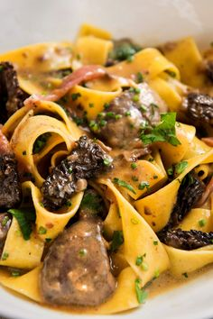 NYT Cooking: Fresh wild mushrooms are the most delicious indulgence, whether it's gray-brown morels in the springtime, golden chanterelles in the summer, or russet-colored porcini in the fall. True, they are expensive (unless you know how to pick your own), but a mere half-pound is all you need for this creamy pasta — and chicken livers are cheap. Serve the pasta in small portions