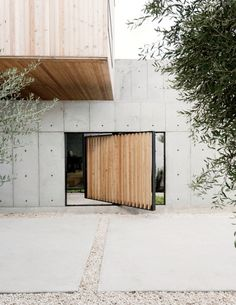 A pivoting door, also made of larch, provides a shortcut to enter the structure…