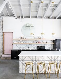 This multipurpose space by Sarah Sherman Samuel showcases multiple 2017 decor trends including pastels with black, marble-slab backsplashes, sharp mosaic tiles and 1960s-inspired lighting. | Photographer: Jeff Mindell