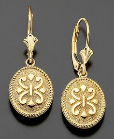 Sparkling emblems of classic beauty. These earrings are crafted in 14k gold. Approximate drop: 1-1/4 inches. | Photo may have been enlarged and/or enhanced. | This item cannot be shipped to American S