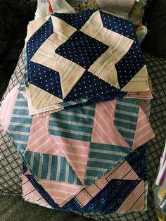 vintage quilt blocks...I love indigo - Interesting quilt block pattern.  It looks like it's made with half square triangles.