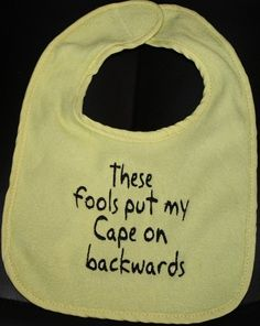 Have guests at baby shower use permanent fabric marker to make their own bib for new baby