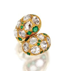 HAMMERED GOLD, DIAMOND AND EMERALD 'YING AND YANG' RING, SUZANNE BELPERRON, CIRCA 1968    Of crossover design set with large rose-cut diamonds, accented by round emeralds