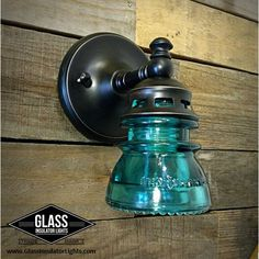 LED Glass Insulator Light Wall Sconce - Wall Light - Bathroom Light This Vintage Glass Insulator Wall Sconce / Wall Light is made from a beautiful Hemingray 42 glass insulator. The vintage glass makes the perfect shade and gives a gorgeous glow. Its vint Bathroom Wall Lights, Bathroom Light Fixtures, Bathroom Lighting, Rustic Lighting, Wall Sconce Lighting, Wall Sconces, Lighting Ideas, Cabin Lighting, Pipe Lighting
