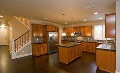 I really like this kitchen, natural wood, backsplash, style, lights.