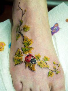 Amazing 3D Ladybug On Ivy Vine Foot Tattoo