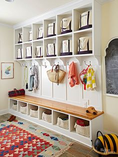 Built-ins keep even a bustling mudroom organized. Within these convenient cubbies, grab-and-go monogrammed canvas totes provide storage for each person in the household. Use spare bags or baskets for sports gear, toys, and returns.
