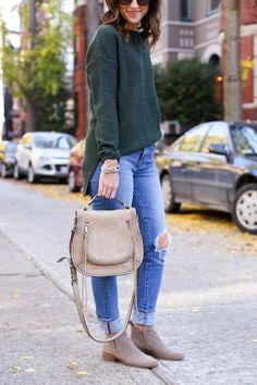 Favorite ripped denim, ankle booties, saddle bag, and sweaters.