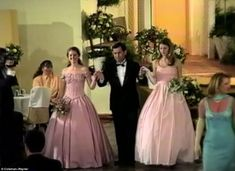 Gisele and her twin sister, Patricia, are escorted through the banquet hall in princess-style pink dresses during their debutant ball