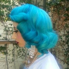Turquoise blue dyed hair in vintage style
