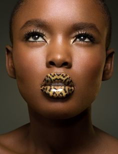 Lip tattoos have become a good option for women who are willing to go bold! Here are our top 15 best lip tattoos for you to adorn your lips in a attractive manner Leopard Tattoos, Brown Skin, Dark Skin, Lipstick Colors, Lip Colors, Lady Gaga, Female Tattoo Models, Female Models, Wörter Tattoos