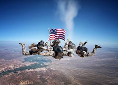 Marines skydiving and spreading the ashes of a fellow fallen Marine in over Arizona