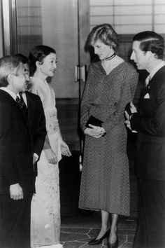 Japan's Crown Prince Akihito and Crown Princess Michiko meeting and speaking with Charles and Diana .