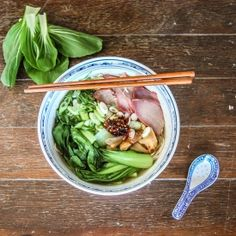 A tasty soup flavoured with shitake mushrooms, served with noodles, barbecue pork, bok choy and spring onions. Easy and delicious!