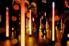 Volume by United Visual Artists | It consists of a field of 48 luminous, sound-emitting columns that respond to movement. Visitors weave a path through the sculpture, creating their own unique journey in light and music.