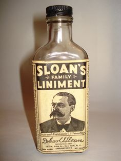 While crooks was sitting down on his bunk bed, he was holding a bottle of Liniment and with his other hand he rubbed his spine. Antique Glass Bottles, Recycled Bottles, Bottles And Jars, Old Medicine Cabinets, Medicine Bottles, Bottle Labels, Vodka Bottle, 8th Grade Ela, Of Mice And Men