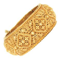 Indian Gold Cuff Bangle Bracelet   Ap. 39.4 dwt. Inner cir. 6 1/2 inches. Width 1 3/16 inches.