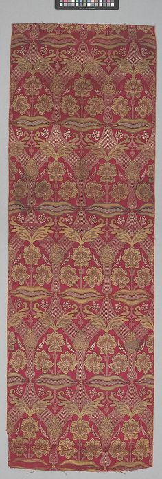 Loom Width with Floral and Tiger-stripe Design  Object Name:     Fragment Date:     16th century Geography:     Turkey, Bursa Culture:     Islamic Medium:     Silk, metal wrapped thread; lampas (kemha) Dimensions:     Textile: L. 79 5/8 in. (202.2 cm) W. 26 1/2 in. (67.3 cm) Mount: H. 83 in. (210.8 cm) W. 30 in. (76.2 cm) D. 2 in. (5.1 cm) Classification:     Textiles