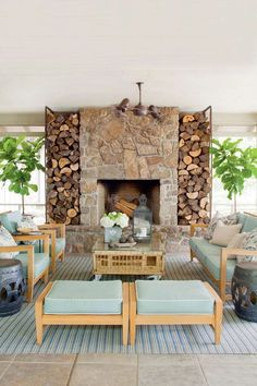 Nature-Inspired Porch - 80 Breezy Porches and Patios - Southernliving. The stone fireplace creates a focal point, adds a heat source, and visually links the porch with the rock columns inside. Tour the Nature-Inspired Lakehouse Southern Living, Country Living, Cabana, Outdoor Rooms, Outdoor Living, Indoor Outdoor, Lakeside Living, Outdoor Kitchens, Outdoor Lounge