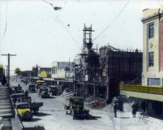 The photograph shows rebuilding of shops and businesses in Dalton Street, Napier. The previous buildings were destroyed in the 3 February 1931 earthquake. Hallenstein Brothers shop is shown on the right. Buildings, February, Forget, Photograph, Shops, Street View, Photography, Tents, Photographs