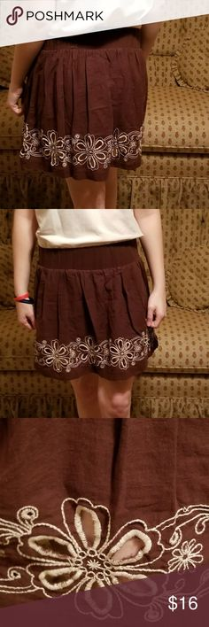 Charlotte Russe skirt A chocolate brown skirt with  white eyelet  stitched flowers around the bottom. Charlotte Russe Skirts