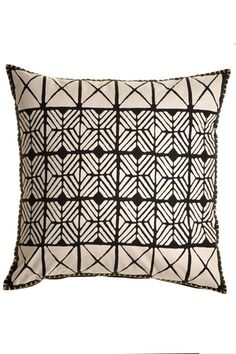 A neutral-toned, African-inspired pillow goes with nearly every color scheme.